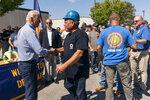 President Joe Biden greets labor union members of the International Brotherhood of Electrical Workers (IBEW) Local 313 in New Castle, Del., commemorating Labor Day, Monday, Sept. 6, 2021. (AP Photo/Manuel Balce Ceneta)