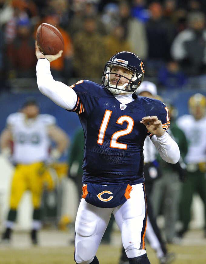 FILE - In this Jan. 23, 2011, Chicago Bears quarterback Caleb Hanie throws a pass during the second half of the NFC Championship NFL football game against Green Bay Packers in Chicago. Green Bay nose tackle B.J. Raji's interception of Chicago third-stringer Hanie's pass gave the Packers a 21-7 lead, and they needed it after being burned by a Hanie-to-Earl Bennett TD a short time later. (AP Photo/Jim Prisching, File)
