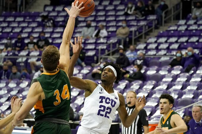 North Dakota State forward Rocky Kreuser (34) blocks a shot attempt by TCU guard RJ Nembhard (22) during the second half of an NCAA college basketball game in Fort Worth, Texas, Tuesday, Dec. 22, 2020. (AP Photo/Tony Gutierrez)