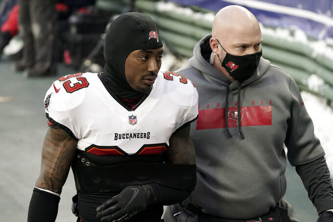 Tampa Bay Buccaneers' Jordan Whitehead is escorted off the field after getting injured against the Green Pay Packers during the second half of the NFC championship NFL football game in Green Bay, Wis., Sunday, Jan. 24, 2021. (AP Photo/Morry Gash)