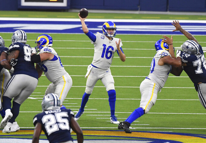 Quarterback Jared Goff (16) of the Los Angeles Rams passes against the Dallas Cowboys in the first half of a NFL football game on opening night at SoFi Stadium in Inglewood on Sunday, September 13, 2020. (Keith Birmingham/The Orange County Register via AP)