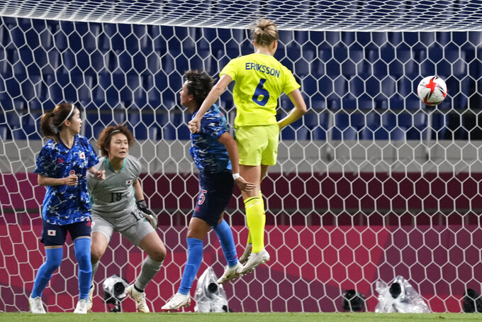 Sweden's Magdalena Eriksson, right, scores the opening goal against Japan during a women's quarterfinal soccer match at the 2020 Summer Olympics, Friday, July 30, 2021, in Saitama, Japan. (AP Photo/Martin Mejia)