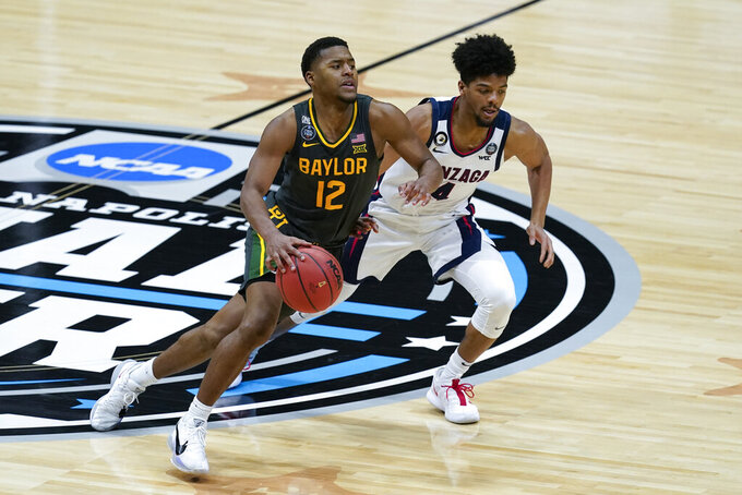 Baylor guard Jared Butler (12) drives up court past Gonzaga guard Aaron Cook (4) during the second half of the championship game in the men's Final Four NCAA college basketball tournament, Monday, April 5, 2021, at Lucas Oil Stadium in Indianapolis. (AP Photo/Darron Cummings)