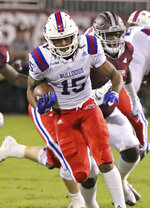 Louisiana Tech running back Kam McKnight (15) runs through a hole in the line and is pursued by Mississippi State defensive tackle Braxton Hoyett (95) during the first half of an NCAA college football game on Saturday, Nov. 3, 2018, in Starkville, Miss. (AP Photo/Jim Lytle)