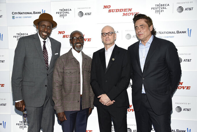 """Actor Bill Duke, left, actor Don Cheadle, director Steven Soderbergh and actor Benicio Del Toro pose together at the """"No Sudden Move"""" premiere during the 20th Tribeca Festival at The Battery on Friday, June 18, 2021, in New York. (Photo by Evan Agostini/Invision/AP)"""