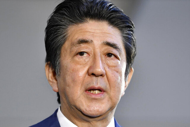 Japan's Prime Minister Shinzo Abe speaks to media at his office Wednesday, Nov. 20, 2019, in Tokyo. Abe has made history by becoming Japan's longest-serving political leader, though he hasn't achieved his biggest goal of revising the nation's pacifist constitution. (Kyodo News via AP)