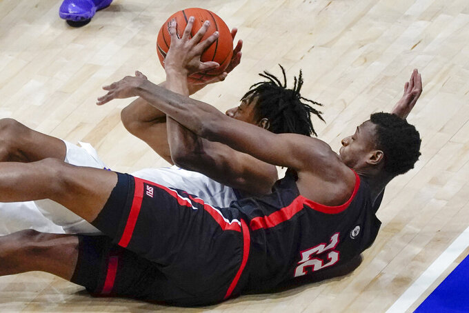 Pittsburgh's Justin Champagnie, left, tries to pass from the floor as St. Francis' Tyler Stewart (22) defends during the second half of an NCAA college basketball game, Wednesday, Nov. 25, 2020, in Pittsburgh. St. Francis won 80-70. (AP Photo/Keith Srakocic)