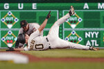 Arizona Diamondbacks shortstop Nick Ahmed, rear, tags out Pittsburgh Pirates' Bryan Reynolds at second during the fifth inning of a baseball game, Tuesday, Aug. 24, 2021, in Pittsburgh. (AP Photo/Keith Srakocic)