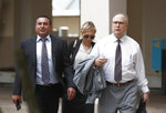 Attorneys for the defendants Lawrence Hashish, left, David Frankel, right, and paralegal Juliana Marulanda, center, walk into the Broward County Jail on Monday, Aug. 26, 2019, in Fort Lauderdale, Fla. Three people, including two nurses, are surrendering following charges in the case of a Florida nursing home where 12 patients died after losing power went out amid sweltering heat following Hurricane Irma in 2017. (AP Photo/Brynn Anderson)