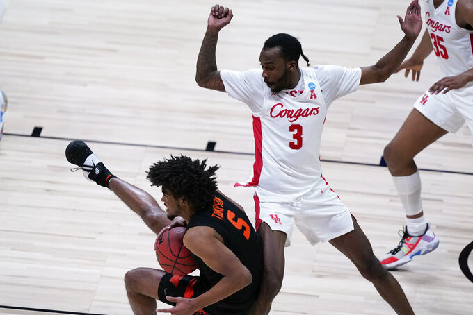 Houston guard DeJon Jarreau (3) guards Oregon State guard Ethan Thompson (5) who falls to the court during the second half of an Elite 8 game in the NCAA men's college basketball tournament at Lucas Oil Stadium, Monday, March 29, 2021, in Indianapolis. (AP Photo/Michael Conroy)