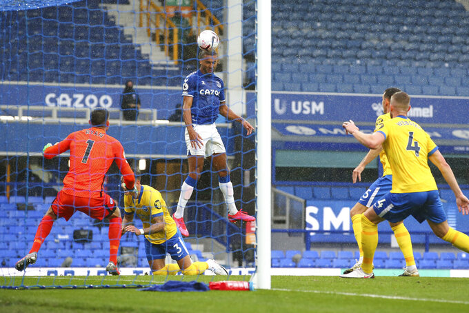Everton's Dominic Calvert-Lewin scores his side's first goal during the English Premier League soccer match between Everton and Brighton at the Goodison Park stadium in Liverpool, England, Saturday, Oct. 3, 2020. (Alex Livesey/Pool via AP)