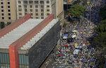 People gather next to the Art Museum during a protest against Brazilian President Jair Bolsonaro, at Avenida Paulista, Sao Paulo, Brazil, Sunday, Sep. 12, 2021. (AP Photo/Marcelo Chello)