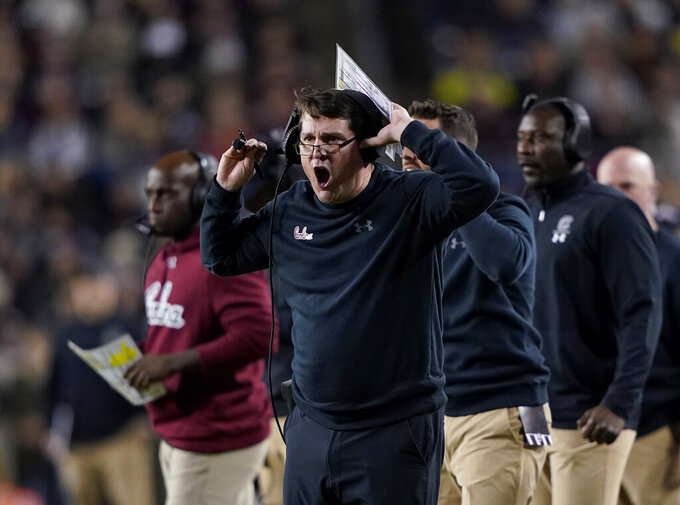 South Carolina coach Will Muschamp yells to the officials during the first quarter of an NCAA college football game against Texas A&M Saturday, Nov. 16, 2019, in College Station, Texas. (AP Photo/David J. Phillip)