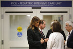 First lady Melania Trump, left, speaks with pediatrician Eileen Costello, front right, as U.S. Secretary of Health and Human Services Alex Azar, behind center, and Chief of Pediatrics Bob Vinci, right, look on during a visit to Boston Medical Center, in Boston, Wednesday, Nov. 6, 2019. The visit, part of the first lady's