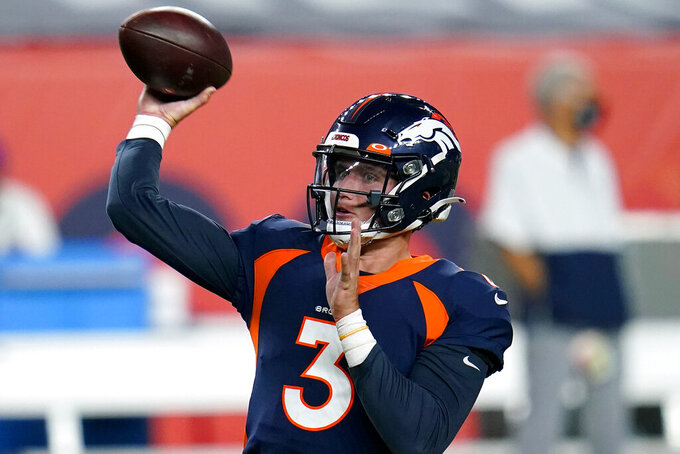 Denver Broncos quarterback Drew Lock (3) warms up prior to an NFL football game against the Tennessee Titans, Monday, Sept. 14, 2020, in Denver. (AP Photo/Jack Dempsey)
