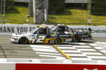 Brandon Jones, right, battles with Sheldon Creed in the number 2 truck before passing him to win the NASCAR Truck Series auto race at Pocono Raceway, Sunday, June 28, 2020, in Long Pond, Pa. (AP Photo/Matt Slocum)