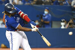 Toronto Blue Jays' Vladimir Guerrero Jr. hits a single during the fourth inning against the Chicago White Sox in a baseball game Wednesday, Aug. 25, 2021, in Toronto. (Jon Blacker/The Canadian Press via AP)