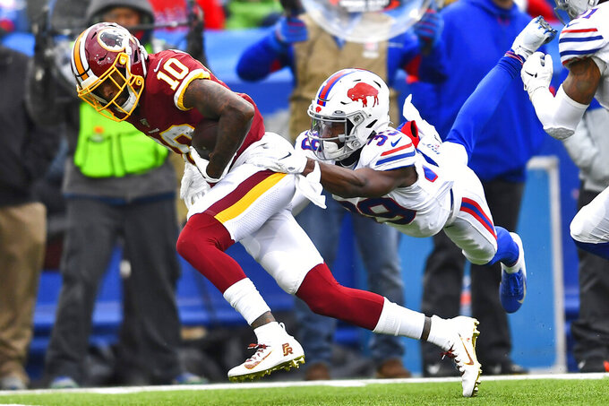 Washington Redskins wide receiver Paul Richardson (10) is tackled by Buffalo Bills defensive back Levi Wallace (39) during the second half of an NFL football game, Sunday, Nov. 3, 2019, in Orchard Park, N.Y. (AP Photo/Adrian Kraus)