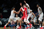 New Mexico guard JaQuan Lyle (5) tries to strip the ball from Wisconsin forward Nate Reuvers (35) in the second half of an NCAA college basketball game in the Legends Classic, Tuesday, Nov. 26, 2019, in New York. New Mexico defeated Wisconsin 59-50. (AP Photo/Kathy Willens)