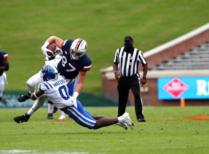 Duke safety Marquis Waters (0) tackles Virginia Cavaliers Tony Polijan (87) during an NCAA college football game Saturday, Sept. 26, 2020, in Charlottesville, Va. (Erin Edgerton/The Daily Progress via AP)