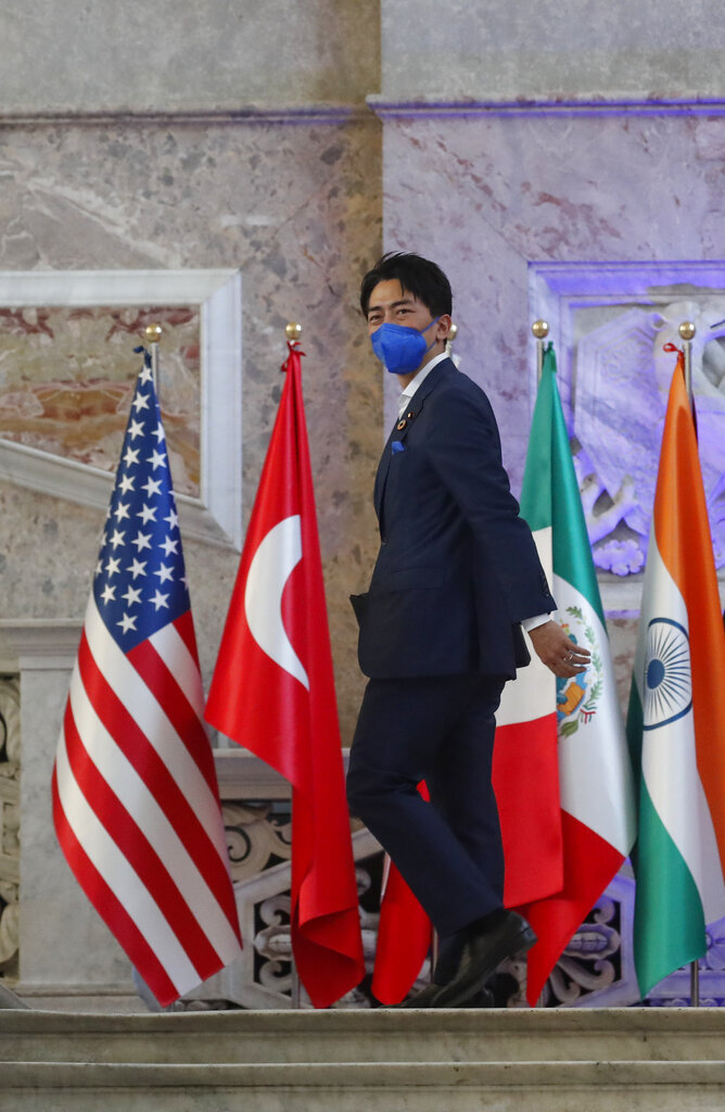 Japan's Environment Minister Shinjirō Koizumi arrives at Palazzo Reale in Naples, Italy, Thursday, July 22, 2021, to take part in a G20 meeting on environment, climate and energy. (AP Photo/Salvatore Laporta)