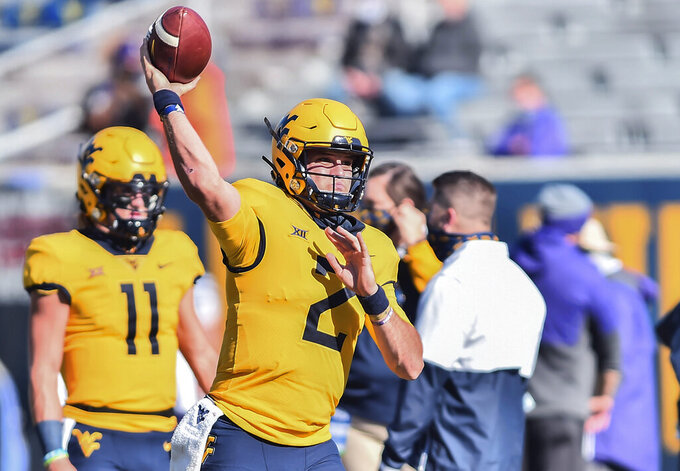 West Virginia's Jarret Doege (2) warms up before an NCAA college football game against Kansas State on Saturday, Oct. 31, 2020, in Morgantown, W.Va.  (William Wotring/The Dominion-Post via AP)