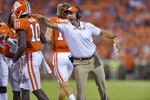 Clemson coach Dabo Swinney congratulates Joseph Ngata after Ngata scored a touchdown against Charlotte during the second half of an NCAA college football game Saturday, Sept. 21, 2019, in Clemson, S.C. (AP Photo/Richard Shiro)