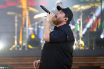 FILE - In this May 13, 2021, file photo, Luke Combs performs at the CMT Music Awards in Nashville, Tenn. Combs is paying the funeral expenses of three young men who saw him perform at a Michigan event before they died from accidental carbon monoxide poisoning at a nearby campground, relatives said. (AP Photo/Mark Humphrey, File)