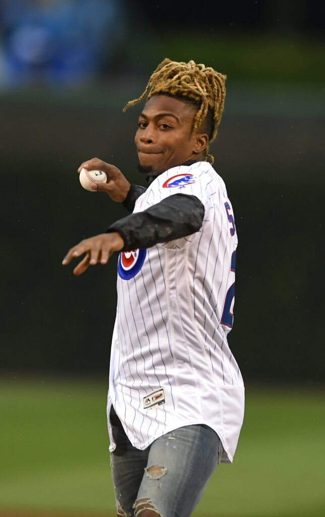 Chicago Bears player Buster Skrine throws out a ceremonial first pitch before a baseball game between the Chicago Cubs and the Chicago White Sox on Wednesday, June 19, 2019, at Wrigley Field in Chicago. (AP Photo/Paul Beaty)