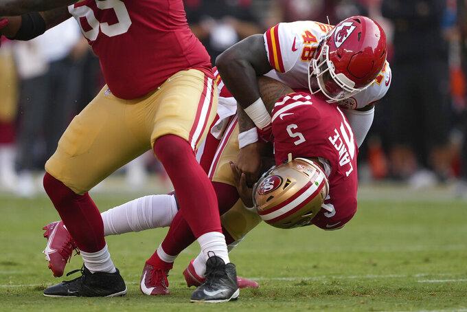 San Francisco 49ers quarterback Trey Lance (5) is sacked by Kansas City Chiefs linebacker Omari Cobb (48) during the first half of an NFL preseason football game in Santa Clara, Calif., Saturday, Aug. 14, 2021. (AP Photo/Tony Avelar)