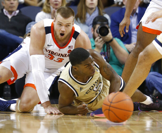 Georgia Tech forward Moses Wright (5) and Virginia center Jack Salt (33) scramble for a loose ball during the first half of an NCAA college basketball game in Charlottesville, Va., Wednesday, Feb. 27, 2019. (AP Photo/Steve Helber)