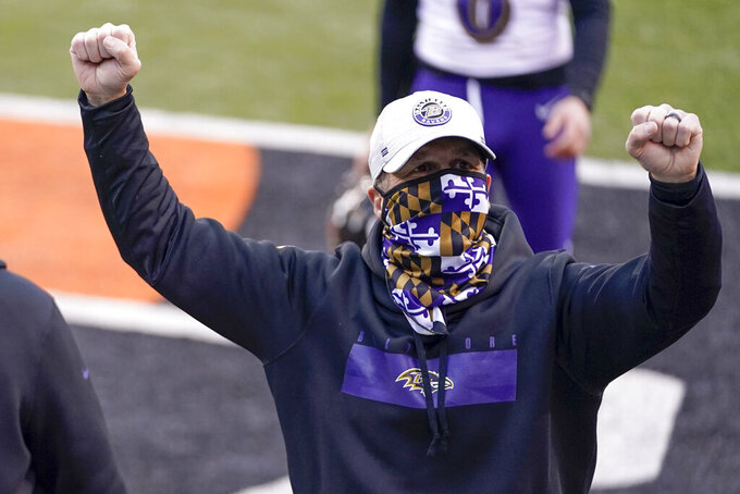 Baltimore Ravens head coach John Harbaugh celebrates after a victory over the Cincinnati Bengals in the NFL football game, Sunday, Jan. 3, 2021, in Cincinnati. (AP Photo/Bryan Woolston)