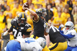 Iowa quarterback Nate Stanley, center, throws a pass during the first half of an NCAA college football game against Middle Tennessee, Saturday, Sept. 28, 2019, in Iowa City, Iowa. (AP Photo/Charlie Neibergall)