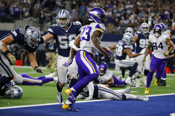 Minnesota Vikings running back Dalvin Cook (33) gets past Dallas Cowboys' Leighton Vander Esch (55) and Sean Lee (50) for a touchdown during the second half of an NFL football game in Arlington, Texas, Sunday, Nov. 10, 2019. (AP Photo/Michael Ainsworth)