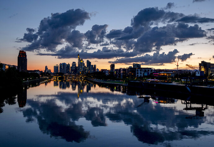 Clouds are seen over the buildings of the banking district after sunset in Frankfurt, Germany, Thursday, June 18, 2020. (AP Photo/Michael Probst)