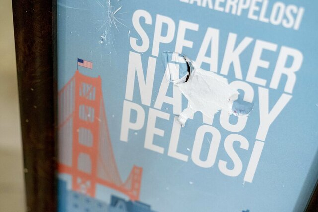 The sign in front of the office of Speaker of the House Nancy Pelosi, D-Calif., is damaged as seen in the early morning hours at the Capitol in Washington, Thursday, Jan. 7, 2021, after protesters stormed the Capitol. (AP Photo/Andrew Harnik)