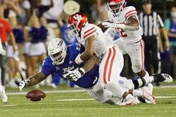 Tulsa offensive lineman Tyler Smith (56) dives on the ball to recover a fumble in front of Houston linebacker Deontay Anderson (2) in the first half of an NCAA college football game Friday, Oct. 1, 2021, in Tulsa, Okla. (AP Photo/Sue Ogrocki)