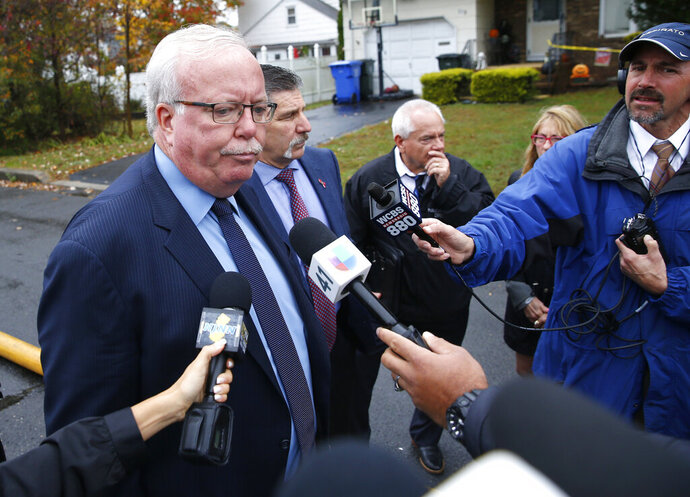 Woodbridge Mayor John McCormac answers questions from media about a Cessna 414 plane that crashed into a home on Tuesday, Oct. 29, 2019, in Woodbridge, N.J. (AP Photo/Noah K. Murray)