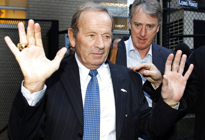 FILE - In this March 11, 2011, file photo, Denver Broncos owner Pat Bowlen gestures to the media after negotiations broke down with the NFL Players Association in Washington. At rear right is Broncos' Joe Ellis. The late Pat Bowlen will be inducted into the Pro Football Hall of Fame in Canton, Ohio on Aug. 3, 2019.(AP Photo/Alex Brandon, File)