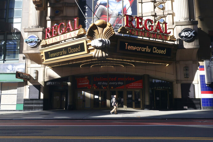 FILE - A Regal Cinemas movie theater is temporarily closed during the coronavirus pandemic in New York on May 5, 2020. Regal movie theaters have been closed for almost five months in the U.S. due to the coronavirus pandemic, but they are gearing up to open on Aug. 21. (AP Photo/Ted Shaffrey, File)
