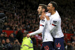 Liverpool's Adam Lallana, left, celebrates with Liverpool's Trent Alexander-Arnold after scoring his side's opening goall during the English Premier League soccer match between Manchester United and Liverpool at the Old Trafford stadium in Manchester, England, Sunday, Oct. 20, 2019. (AP Photo/Jon Super)