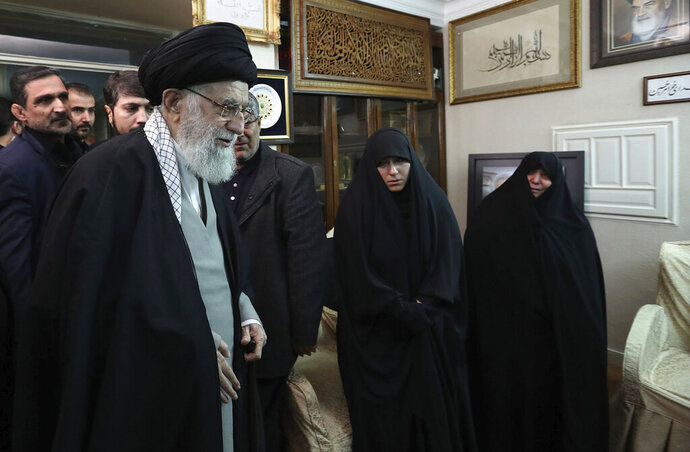 In this picture released by the official website of the office of the Iranian supreme leader, Supreme Leader Ayatollah Ali Khamenei meets family of Iranian Revolutionary Guard Gen. Qassem Soleimani, who was killed in the U.S. airstrike in Iraq, at his home in Tehran, Iran, Friday, Jan. 3, 2020. Iran has vowed