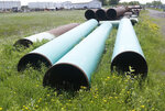 FILE - In this June 29, 2018, file photo, pipeline used to carry crude oil is shown at the Superior, Wis., terminal of Enbridge Energy. A significant permit has been granted to Enbridge's plan to replace its aging Line 3 oil pipeline across northern Minnesota. (AP Photo/Jim Mone, File)