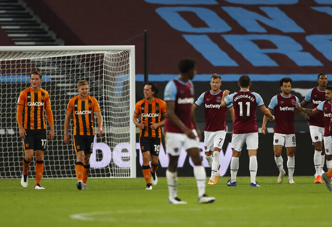 West Ham's Andriy Yarmolenko celebrates with teammates after scoring his side's third goal from the penalty spot during the English League Cup soccer match between West Ham and Hull City at the London Stadium in London, Tuesday, Sept. 22, 2020. (AP Photo/Alastair Grant, Pool)