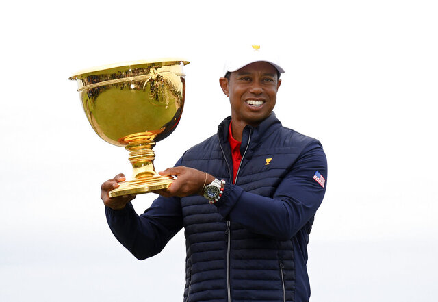 U.S. team player and captain Tiger Woods holds up the trophy after the U.S. team won the President's Cup golf tournament at Royal Melbourne Golf Club in Melbourne, Sunday, Dec. 15, 2019. The U.S. team won the tournament 16-14. (AP Photo/Andy Brownbill)