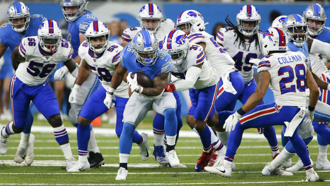 Detroit Lions running back Ty Johnson (38) is pursued by the Buffalo Bills' defense during the first half of an NFL preseason football game in Detroit, Friday, Aug. 23, 2019. (AP Photo/Duane Burleson)