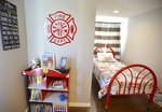 The boys room at the Isaiah 117 House was decorated by the Elizabethton Fire Department and carries a firefighter theme throughout the room. Isaiah 117 House is a nonprofit organization that provides a safe space for children who have been taken from their homes into Tennessee Department of Children's Services custody until caseworkers can find foster homes for them.(David Crigger/Bristol Herald Courier via AP)