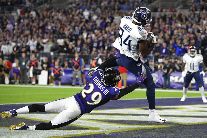 Tennessee Titans wide receiver Corey Davis (84) makes a touchdown catch against Baltimore Ravens free safety Earl Thomas (29) during the second half an NFL divisional playoff football game, Saturday, Jan. 11, 2020, in Baltimore. (AP Photo/Nick Wass)
