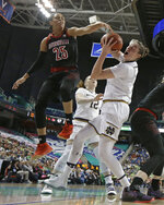 Louisville's Asia Durr (25) tries to block a drive by Notre Dame's Jessica Shepard during the first half of an NCAA college basketball game in the championship of the Atlantic Coast Conference women's tournament in Greensboro, N.C., Sunday, March 10, 2019. (AP Photo/Chuck Burton)