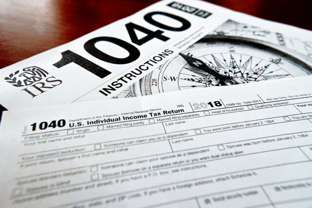 FILE- This Feb. 13, 2019, file photo shows multiple forms printed from the Internal Revenue Service web page that are used for 2018 U.S. federal tax returns in Zelienople, Pa.  The majority of individual taxpayers in the U.S. are eligible to file their taxes for free, yet many may be unaware or confused by how to do so.    Improvements have been made and Free File should be easier to use in 2020. But, with tax season getting into full gear, users should be aware of the details of the service and alternatives. (AP Photo/Keith Srakocic, File)